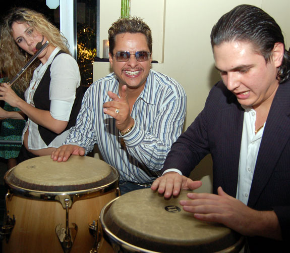 Latin music producer Tito Puente, Jr., plays his bongos for guests at the two-year anniversary party for popular Ivy Aventura in Loehmann's Plaza in Aventura.