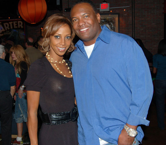 Holly Robinson and Rodney Peete pose for ABM's cameras at Alonzo Mourning's charity bowling event at Lucky Strike on South Beach.